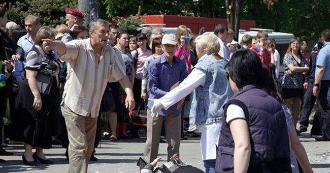Ukraine's president goes to city hit by blasts