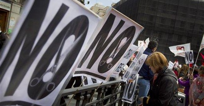 Thousands protest health, education cuts in Spain