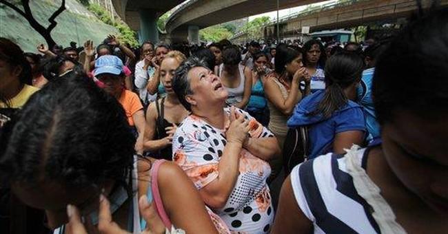 Gunfire erupts at Venezuela prison, troops outside