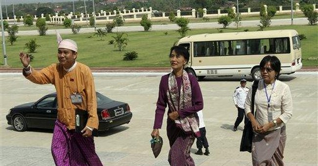 Myanmar begins new era as Suu Kyi joins parliament
