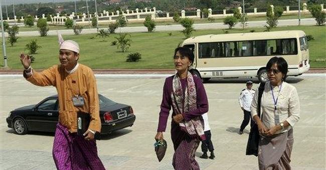 Myanmar begins new era as Suu Kyi joins parliament