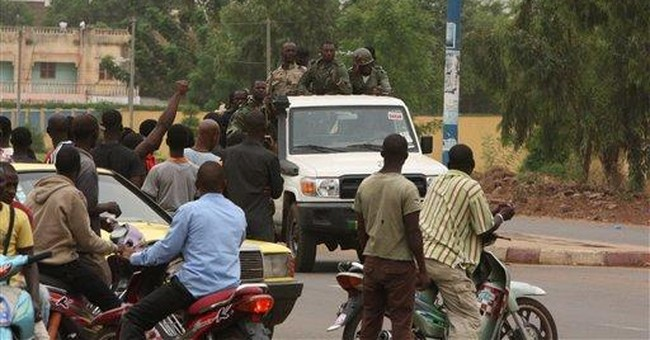 Junta takes camp in Mali capital, claims control