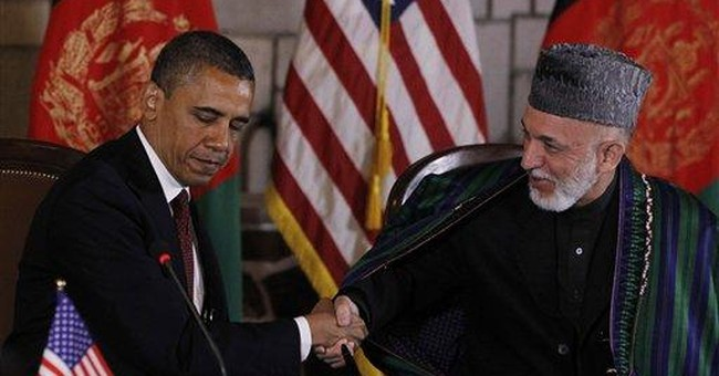US-Afghan pact achieved despite Karzai's rhetoric