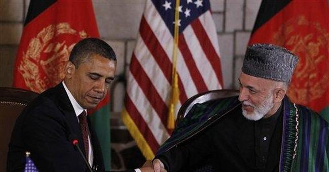 US-Afghan pact achieved despite Karzai's rhetoric