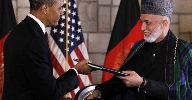 Afghanistan security deal Obama signed has holes