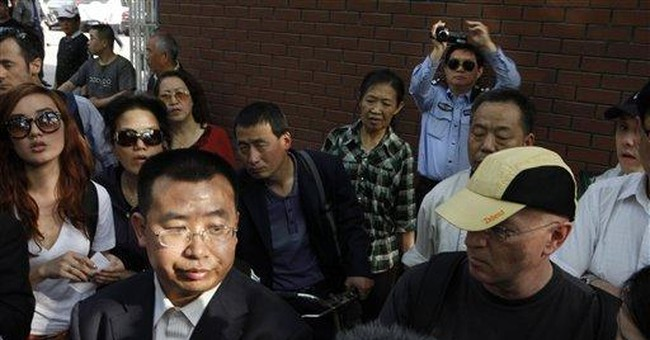 Deal undone? Activist now wants to leave China