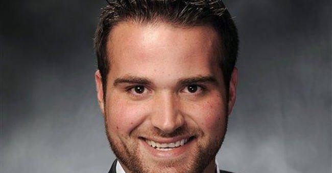 Mo. lawmaker says he is gay, denounces school bill