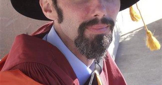 Rocking scholar graduates with devil-horn salute