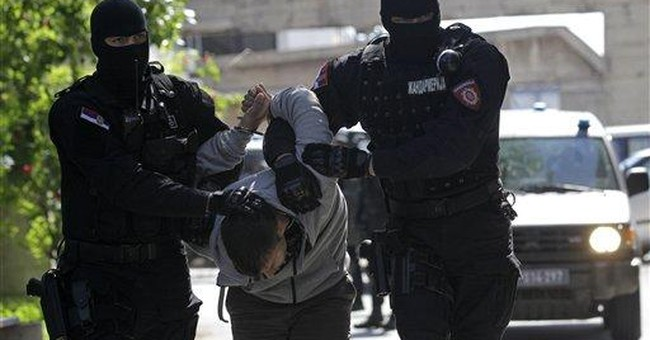 Serbia police arrest 8 in tense south