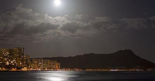 AP Photos: Supermoon glows around the globe