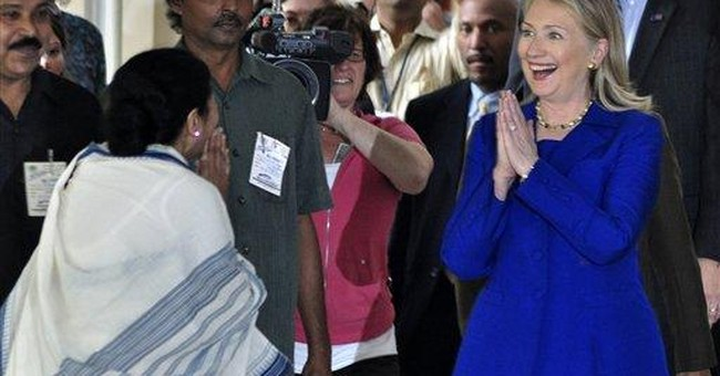 Clinton presses India to cut oil imports from Iran
