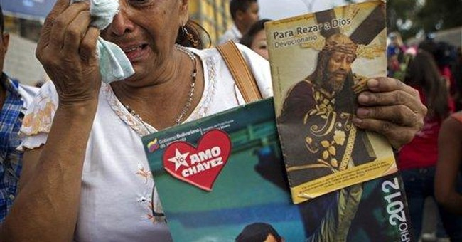 Hugo Chavez looks to God as cancer clouds future