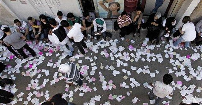 Syrians vote in election dismissed as a sham