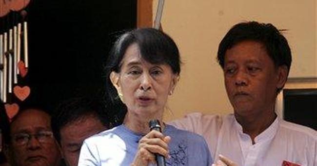 Myanmar's Suu Kyi given first passport in 24 years