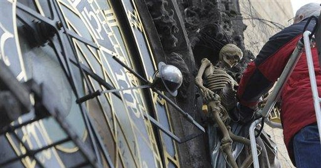 Prague Astronomical clock figures being repaired