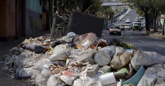 Mexico City fights trash pileup after closing dump