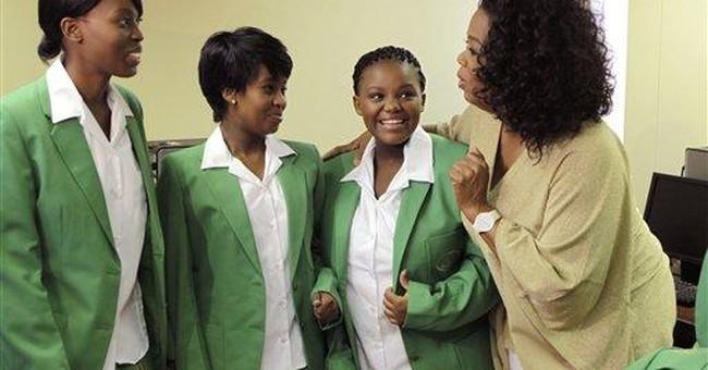 AP Interview: Winfrey celebrates 1st graduates