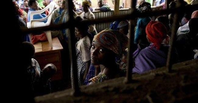 Congolese flee violence into neighboring Rwanda