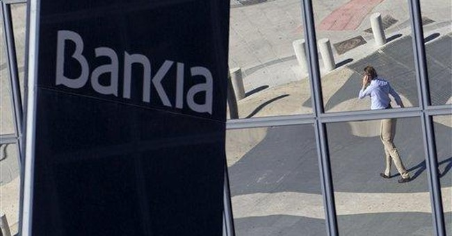 Spain nationalizes No. 4 bank as crisis deepens