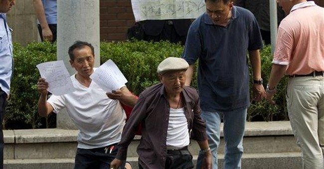 China tightens restrictions on activist's family