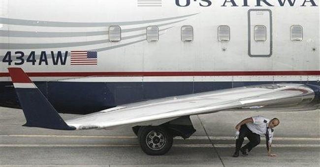 Mass. police: NC man tried to open jet cabin door