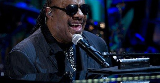 Two charged with trying to extort Stevie Wonder