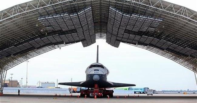 AP Photos: Enterprise's final journey continues