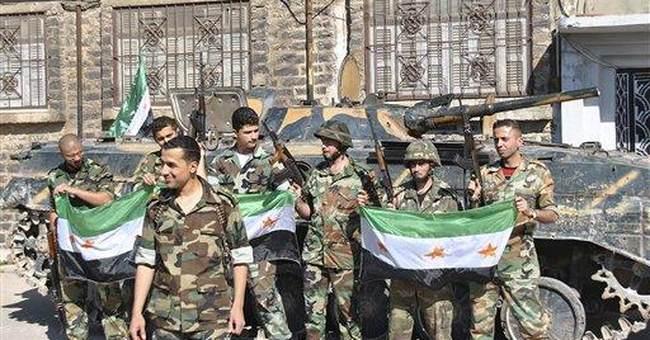 Syrians raid village, violence bleeds into Lebanon