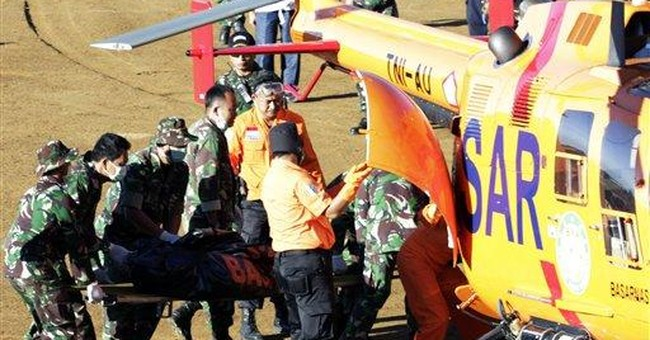 Indonesia teams scour ravine for plane's black box