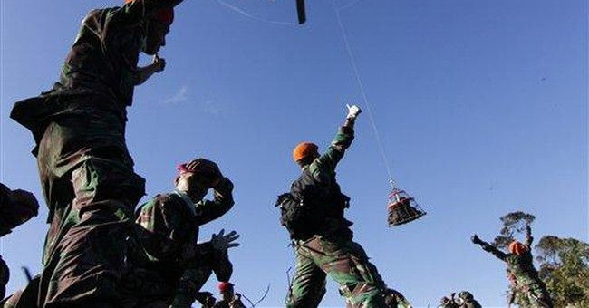 Climbers try to reach jet's black box in Indonesia