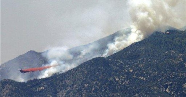 Crews battling Ariz. wildfire fight high winds