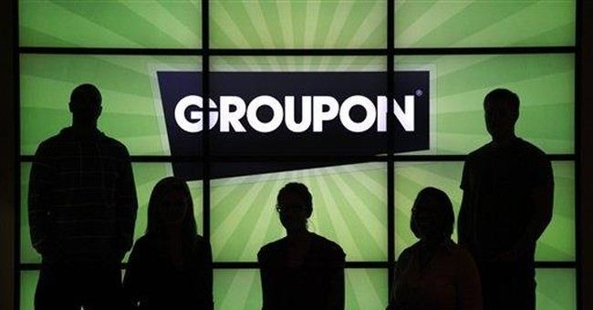 Groupon reports smaller 1Q loss, higher revenue