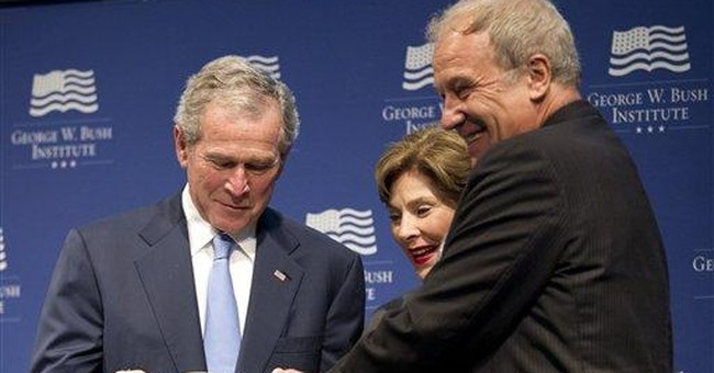 George W. Bush offers tepid endorsement of Romney
