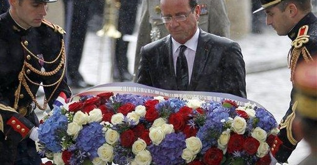 France's Hollande gets soaked in 1st procession