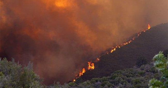 Ariz. wildfire to keep growing amid strong winds
