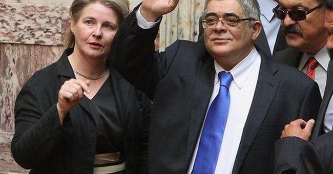 Caretaker Greek Cabinet, legislators sworn in