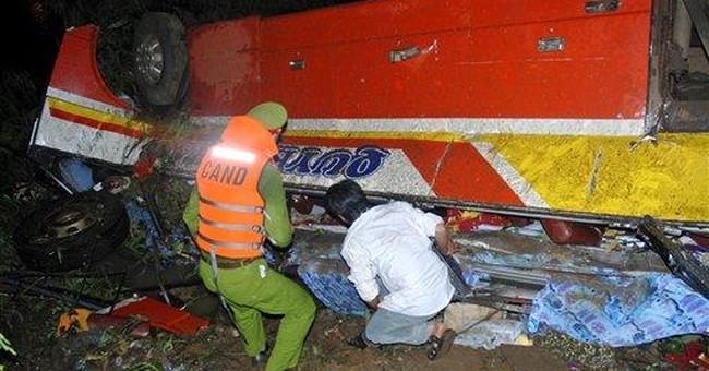 Vietnam bus plunges off bridge into river; 34 dead