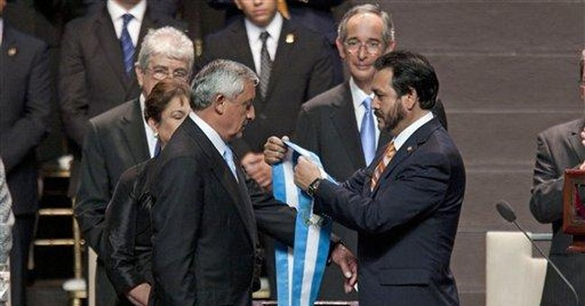 Guatemala leader takes office pledging 'iron fist'