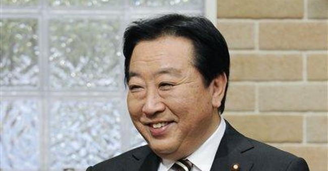 PM says Japan must tackle debt to avoid rate cut