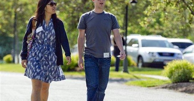 Day after historic IPO, Facebook's Zuckerberg weds