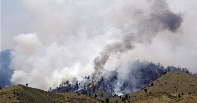 Large Colo. wildfire nearly contained