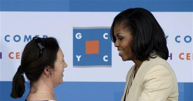 Michelle Obama, NATO spouses visit youth center