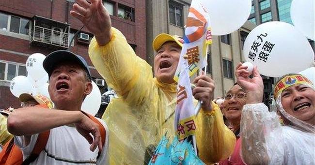 Taiwan's Ma signals no China change as term starts