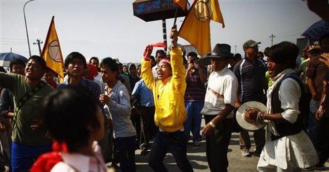 Nepal police detain protesters enforcing strike