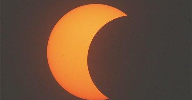 Millions look skyward as eclipse crosses Asia, US