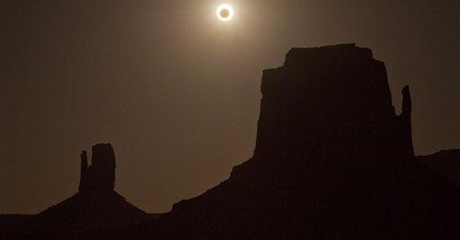 AP Photos: Millions view 'ring of fire' eclipse