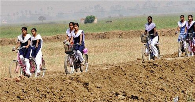 Free bicycles help keep Indian girls in school