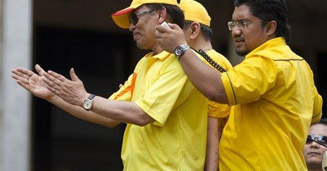 Malaysian opposition's Anwar charged over protest