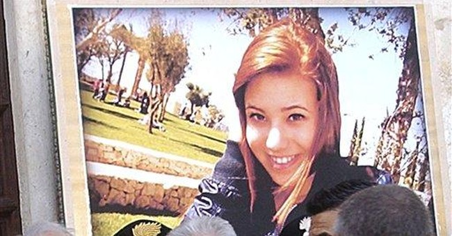 Monti embraces dad of girl slain by school bomb