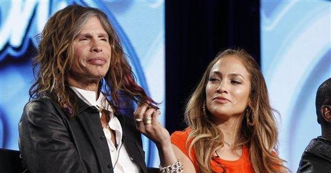'Idol' judge Tyler charmed by 'sexy beast' J-Lo